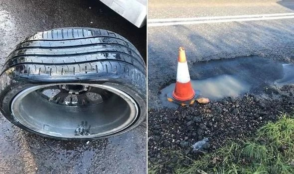 A damaged wheel caused by a pothole