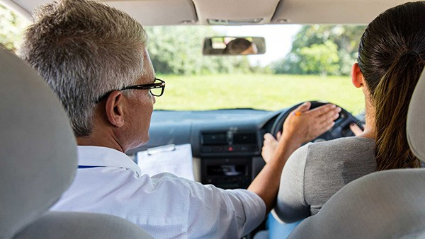 A picture of a lady on a driving lesson