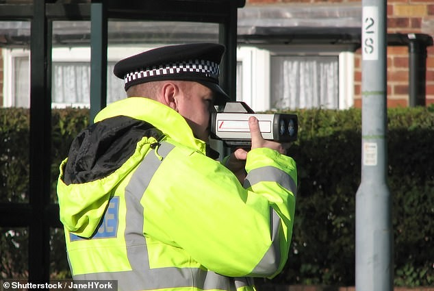 A picture of a police man with a speed gun