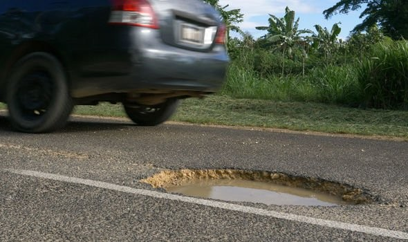 A pothole in the road