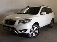 USED 2012 12 HYUNDAI SANTA FE 2.2 PREMIUM CRDI 5d AUTO 194 BHP 7 SEATER LEATHER PDC FSH 4WD. 7 SEATER. STUNNING WHITE WITH FULL BLACK LEATHER TRIM. ELECTRIC HEATED SEATS. CRUISE CONTROL. 18 INCH ALLOYS. COLOUR CODED TRIMS. PRIVACY GLASS. PARKING SENSORS. BLUETOOTH PREP. CLIMATE CONTROL. TRIP COMPUTER. R/CD PLAYER. MFSW. TOWBAR. MOT 03/18. ONE PREV OWNER. FULL SERVICE HISTORY. PRISTINE CONDITION. FCA FINANCE APPROVED DEALER. TEL 01937 849492
