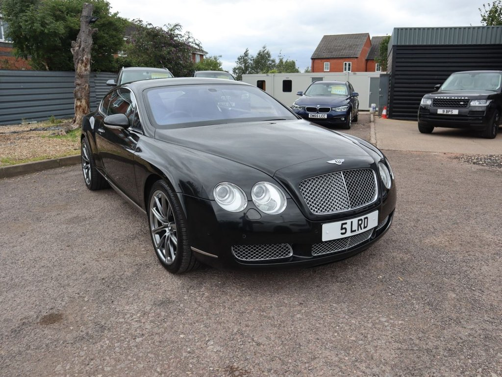 USED 2005 BENTLEY CONTINENTAL 6.0 GT 2d AUTO 550 BHP This stunning example has 9 Bentley dealership/specialist service stamps. Its presented in Beluga Black with full Black leather interior & extended piano wood trim. This example comes with colour screen satellite navigation, front and rear air conditioning. With an electric memory Leather steering wheel with paddle shift gear change, Xenon headlights, electric heated, folding door mirrors. Also with speed alloys, chrome tail pipe and a soft close boot lid this really has luxury options