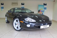 USED 2004 53 JAGUAR XK8 COUPE 4.2 COUPE 2d AUTO 292 BHP THIS AFFORDABLE FUTURE CLASSIC CAR, IS ABSOLUTELY STUNNING AND BENEFITS FROM HAVING A FULL SERVICE HISTORY. THIS VEHICLE HAS BEEN CARED FOR REGARDLESS OF COST.