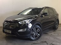USED 2014 14 HYUNDAI SANTA FE 2.2 PREMIUM SE CRDI 5d AUTO 194 BHP 7 SEATER SAT NAV LEATHER ONE OWNER FSH NEW SHAPE. 4WD. 7 SEATER. SATELLITE NAVIGATION. PANORAMIC SUNROOF. STUNNING BLACK MET WITH FULL BLACK LEATHER TRIM. ELECTRIC HEATED SEATS. CRUISE CONTROL. 19 INCH ALLOYS. COLOUR CODED TRIMS. PRIVACY GLASS. PARKING SENSORS. PARK ASSIST. REVERSING CAMERA. BLUETOOTH PREP. CLIMATE CONTROL. TRIP COMPUTER. R/CD PLAYER. MFSW. TOWBAR. MOT 06/18. ONE OWNER FROM NEW. FULL SERVICE HISTORY. PRISTINE CONDITION. FCA FINANCE APPROVED DEALER. TEL 01937 849492