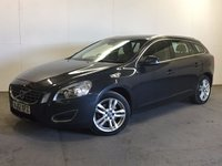 USED 2012 12 VOLVO V60 1.6 D2 SE LUX NAV 5d 113 BHP SAT NAV SUNROOF LEATHER FSH £30 YEAR ROAD TAX. 62 MPG. SATELLITE NAVIGATION. SUNROOF. STUNNING GREY MET WITH FULL BLACK LEATHER TRIM. ELECTRIC MEMORY HEATED SEATS. CRUISE CONTROL. 17 INCH ALLOYS. COLOUR CODED TRIMS. PARKING SENSORS. BLUETOOTH PREP. CLIMATE CONTROL. R/CD PLAYER. 6 SPEED MANUAL. MFSW. TOWBAR. MOT 06/18. ONE PREV OWNER. FULL DEALER SERVICE HISTORY. PRISTINE CONDITION. FCA FINANCE APPROVED DEALER. TEL 01937 849492