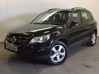 USED 2009 09 VOLKSWAGEN TIGUAN 2.0 ESCAPE TDI 5d 138 BHP 4WD AIR CON ALLOYS MOT 06/18 FSH 4WD. STUNNING BLACK MET WITH CONTRASTING BLACK CLOTH TRIM. 17 INCH ALLOYS. COLOUR CODED TRIMS. MULTIMEDIA SCREEN. CLIMATE CONTROL. R/CD PLAYER. 6 SPEED MANUAL. MFSW. MOT 06/18. FULL SERVICE HISTORY. RECENT TIMING BELT CHANGED. FCA FINANCE APPROVED DEALER. TEL 01937 849492.