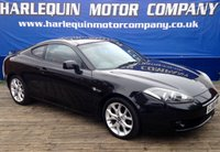 USED 2008 58 HYUNDAI S-COUPE 2.0 SIII 3d AUTO 141 BHP METALLIC BLACK HYUNDAI 2.0 SIII AUTOMATIC WITH OX BLOOD RED HEATED LEATHER ALLOYS ELECTRIC WINDOWS AIR CON ONLY 72000 MILES WITH FULL SERVICE HISTORY