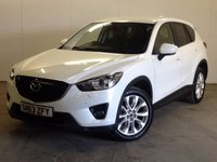 USED 2013 63 MAZDA CX-5 2.2 D SPORT NAV 5d AUTO 173 BHP 4WD SAT NAV LEATHER ONE OWNER FSH NO FINANCE REPAYMENTS FOR 2 MONTHS STC. 4WD AUTO. SATELLITE NAVIGATION. STUNNING WHITE WITH FULL BLACK LEATHER TRIM. ELECTRIC HEATED SEATS. CRUISE CONTROL. 19 INCH ALLOYS. COLOUR CODED TRIMS. PRIVACY GLASS. PARKING SENSORS. REVERSING CAMERA. BLUETOOTH PREP. AIR CON. MULTIMEDIA SYSTEM. R/CD/DAB RADIO. MFSW. MOT 08/18. ONE OWNER FROM NEW. SERVICE HISTORY. FCA FINANCE APPROVED DEALER. TEL 01937 849492