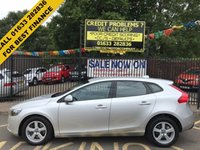USED 2015 65 VOLVO V40 1.5 T2 ES 5d AUTO 120 BHP STUNNING ARTIC SILVER METALLIC PAINT, CHARCOAL CLOTH INTERIOR, LOAD COVER, ALLOY WHEELS, REAR PARKING SENSORS, DAB RADIO, A/C, CRUISE, BLUETOOTH, VERY LOW MILEAGE, VOLVO SERVICE HISTORY