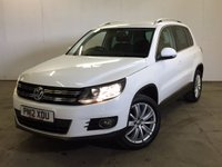 USED 2012 12 VOLKSWAGEN TIGUAN 2.0 SPORT TDI BLUEMOTION TECHNOLOGY 4MOTION 5d 138 BHP FACELIFT PRIVACY FSH NO FINANCE REPAYMENTS FOR 2 MONTHS STC. 4WD FACELIFT MODEL. STUNNING WHITE WITH BLACK CLOTH SPORTS TRIM. CRUISE CONTROL. 18 INCH ALLOYS. COLOUR CODED TRIMS. PRIVACY GLASS. PARKING SENSORS. BLUETOOTH PREP. MULTIMEDIA SCREEN. CLIMATE CONTROL. TRIP COMPUTER. R/CD/MP3 PLAYER. 6 SPEED MANUAL. MFSW. MOT 08/18. FULL SERVICE HISTORY. FCA FINANCE APPROVED DEALER. TEL: 01937 849492.