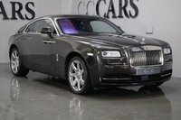 USED 2014 64 ROLLS-ROYCE WRAITH 6.6 V12 2d 624 BHP DESIRABLE SPEC 21 INCH 7 SPOKE POLISHED ALLOY WHEELS BALANCE OF FOUR YEAR WARRANTY AND FREE SERVICING SERVICE JUST COMPLETED ELECTRIC DOOR OPENING HEADS UP DISLAY LANE DEPARTURE WARNING GLASS ROOF WITH ELECTRIC BLIND REVERSE AND 360 DEGREE CAMERAS  FANTASTIC COLOUR COMBINATION PLEASE CALL FOR  DETAILED SPECIFICATIONS STUNNING THROUGHOUT