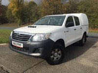 USED 2012 12 TOYOTA HI-LUX 2.5 HL2 4X4 D-4D DCB 1d 142 BHP TRUCKMAN CANOPY LOAD LINER KIT ONE OWNER FSH COMMERCIAL (£10900+2180VAT). 4WD. TRUCKMAN CANOPY. STUNNING WHITE WITH FULL GREY CLOTH TRIM. AIR CON. COLOUR CODED TRIMS. LOAD LINER KIT. PAS. R/CD PLAYER. MFSW. MOT 09/18. ONE OWNER FROM NEW. FULL SERVICE HISTORY. FCA FINANCE APPROVED DEALER. TEL 01937 849492