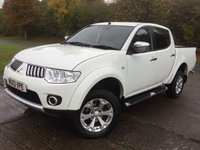 USED 2013 13 MITSUBISHI L200 2.5 DI-D 4X4 WARRIOR LB DCB 1d 175 BHP 4WD LEATHER RUNNING BOARDS LOAD COVER NO VAT NO FINANCE REPAYMENTS FOR 2 MONTHS STC. NO VAT. 4WD. STUNNING WHITE WITH FULL BLACK LEATHER WARRIOR TRIM. SIDE STEPS. CARGO LINING. LOAD COVER. CRUISE CONTROL. AIR CON. 17 INCH ALLOYS. COLOUR CODED TRIMS. PRIVACY GLASS. PAS. R/CD PLAYER. MFSW. MOT 07/18. ONE PREV OWNER. FULL SERVICE HISTORY. FCA FINANCE APPROVED DEALER. TEL 01937 849492