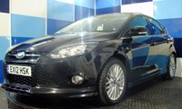 """USED 2012 09 FORD FOCUS 1.6 ZETEC S TDCI 5d 113 BHP A wonderful example of this highly desirable and reliable family hatchback finished in metalic black with the zetec s body kit contrasted with unmaked 17 """" alloys with almost new tyres .This car comes with rear park assist satelite navigation dab radio and full bluetooth prep,this car returns a very ecconomical combined mpg of 67.3 with a £20 ayear road tax, a car not to be missed"""
