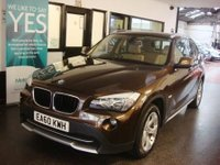 USED 2010 60 BMW X1 2.0 XDRIVE20D SE 5d AUTO 174 BHP This X1 X Drive 20D SE Automatic is finished in Marrakesh Metallic with Beige nevada heated leather seats. It is fitted with power steering, remote locking, electric windows and mirrors, air conditioning, sun protection glass, heated front seats, front and rear parking sensors, Bluetooth, luggage compartment net, auto dimming mirror, rsin sensor with auto lights, extended interior light package alloy wheels, CD Stereo and more.
