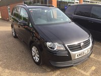 USED 2009 59 VOLKSWAGEN TOURAN 1.9 MATCH TDI BLUEMOTION 5 DOOR 103 BHP IN BLACK WITH SAT NAV.  APPROVED CARS ARE PLEASED TO OFFER THIS  VOLKSWAGEN TOURAN 1.9 MATCH TDI BLUEMOTION 5 DOOR 103 BHP IN BLACK WITH SAT NAV,THIS CARS IN GREAT CONDITION WITH A FULL SERVICE HISTORY SERVICED AT 16K,25K,35K,46K,56K AND 71K (INCLUDING CAM BELT AND WATER PUMP FITTED AT 46924 MILES).