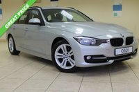USED 2014 14 BMW 3 SERIES 2.0 318D SPORT TOURING 5d AUTO 141 BHP SATELLITE NAVIGATION, DOUBLE SPOKE ALLOYS, SPORTS LEATHER STEERING WHEEL, THROUGH LOAD FACILITY, BLACK HIGH GLOSS INTERIOR TRIM, REAR PDC, RAIN SENSOR, CRUISE, LIGHT PK, BLACK ROOF RAILS