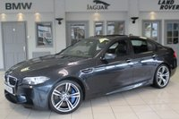 USED 2014 63 BMW M5 4.4 4d 553 BHP FULL BLACK LEATHER SEATS + FULL BMW SERVICE HISTORY + PRO SAT NAV + HEADS UP DISPLAY + ELECTRIC SUNROOF + ADAPTIVE XENON HEADLIGHTS + HEATED FRONT SEATS + DAB RADIO + 19 INCH ALLOYS + ENHANCED BLUETOOTH + HI/FI LOUD SPEAKER SYSTEM + PARKING SENSORS