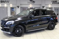 USED 2013 13 MERCEDES-BENZ M CLASS 5.5 ML63 AMG 5d AUTO 525 BHP FULL MERCEDES BENZ SERVICE HISTORY + FULL BLACK LEATHER SEATS + COMAND SAT NAV + REVERSE CAMERA + TWIN SUN ROOF + HEATED FRONT SEATS + BLUETOOTH + 21 INCH ALLOYS + XENON HEADLIGHTS + DAB RADIO