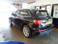 "USED 2010 AUDI Q5 3.0 TDI QUATTRO S LINE 5d AUTO 240 BHP This Fully loaded spec Q5 S Line Quattro is finished in Black with Black heated leather & Alcantara trim with S Line Embossed front seats. It is fitted with power steering, 7 speed auto with paddle shift gear change, Audi Navigation, rear parking camera, remote locking, electric windows, mirrors with power tailgate, climate control, front and rear parking sensors, Auto lights- Xenon, LED day lights, Bluetooth, cup holders, Bang & Olufsen sound, 7 spoke 20"" Wheels, CD Stereo with Media connection"