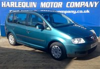 USED 2004 04 VOLKSWAGEN TOURAN 1.9 S TDI 7 STR 5d 99 BHP HERE WE HAVE THE MOST POP 7 SEATER IN ITS RANGE THE V/W TOURAN 1.9 TURBO DIESEL 7 SEATS MANUAL FULL SERVICE HISTORY IN TURQUOISE METALLIC DONT MISS OUT