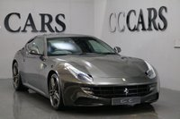 USED 2013 62 FERRARI FF 6.3 V12 3d 660 BHP VAT QUALIFYING  FULL SERV HISTORY JUST SERVICED CHARCOAL LEATHER HEATED SEATS/CONTRAST WHITE STITCH 20 INCH MATT GREY FORGED ALLOY WHEELS BRAND NEW TYRES CERAMIC BRAKES, CARBON FIBRE DRIVER ZONE STEERING WHEEL + LEDs, REAR SEAT ENTERTAINMENT PACK + DIGITAL TV, SATELLITE NAVIGATION + BLUETOOTH CONNECTIVITY, FRONT AND REAR PARK DISTANCE CONTROL + REAR PARKING CAMERA, SCUDERIA FERRARI WING SHIELDS, PRIVACY GLASS, COLOURED CONTRAST STITCHING, NAVTRAK SYSTEM, TYRE PRESSURE MONITORING SYSTEM