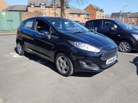 USED 2014 14 FORD FIESTA 1.2 ZETEC 5d 81 BHP CHEAP TO RUN AND EXCELLENT SPECIFICATION WITH PARKING SENSORS, ALLOY WHEELS, AND FRONT HEATED SCREEN. ONLY £30 ROAD TAX AND AND GREAT FUEL ECONOMY! EXCEPTIONAL LOW MILEAGE OF 4992 MILES AND FULL HISTORY FROM FORD!