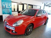 """USED 2014 64 ALFA ROMEO GIULIETTA 2.0 JTDM-2 SPORTIVA NAV 5d 150 BHP This Alfa Guilietta Sportiva Nav JTDM is finished in Rosso Red, silver mirror caps with Black heated electric lumbar supported leather & Suede Alfa embossed seats. It is fitted with power steering, Alfa Satellite Navigation D A B remote locking, electric windows, power fold mirrors, cruise control, 18"""" Alloy Wheels painted in grey, aux & USB ports, start stop, led day lights, dual zone air conditioning, natural/ all weather and dynamic mode driving modes, park assist, alloy wheels and more."""