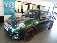 "USED 2015 15 MINI HATCH COOPER 1.5 COOPER 3d 134 BHP This petrol powered Mini Cooper is finished in British racing green with black roof and wheels, with black and white bonnet stripes & Black heated leather seats. Its extras from new include runflat tyres, metallic paint, leather, chrome line interior, piano black interior, auto dimming mirrors, heated seats, park assist, visual boost radio, Chili pack, 16"" alloys and more. Its £20 to road tax and will average 50 mpg +  It has had one private owner from new."