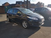 USED 2014 64 FORD FIESTA 1.0 ZETEC 5d 99 BHP EXCEPTIONALLY CHEAP TO RUN BUT WITH GOOD PERFORMANCE! ONLY 99G/KM AND £0 ROAD TAX! WITH EXCELLENT SPECIFICATION INCLUDING AIR CONDITIONING, MEDIA , BLUEOOTH, ALLOY WHEELS AND FRONT HEATED WINDSCREEN!