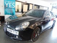 "USED 2014 64 ALFA ROMEO GIULIETTA 2.0 JTDM-2 SPORTIVA NAV 5d 150 BHP This 150 BHP Alfa Guilietta Sportiva Nav JTDM is finished in black metallic, silver mirror caps with Black electric lumbar supported leather & Suede Alfa embossed seats. It is fitted with power steering, Alfa Satellite Navigation D A B remote locking, electric windows, power fold mirrors, cruise control, 18"" Alloy Wheels painted in grey, aux & USB ports, start stop, led day lights, dual zone air conditioning, natural/ all weather and dynamic mode driving modes, park assist, alloy wheels."