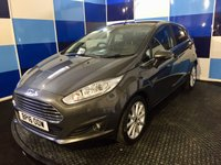 """USED 2016 16 FORD FIESTA 1.6 TITANIUM 5d AUTO 104 BHP A wonderfull example of this very highly regarded small family hatchback finished in unmarked metalic grey contrasted with 16"""" silver alloys .This car comes equiped with all the usual titanium refinements including cruise control ford sync on bluetooth and music air conditioning dab radio plus lots more ,Sadly the car has sustained minor accident damage and is recorded as cat d on v car ,however this is reflected in the price with a massive saving on retail price,any inspection welcomed."""