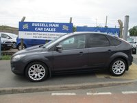 USED 2010 10 FORD FOCUS 1.6 ZETEC 5d 100 BHP 8 Stamps Of Service History .2 Former Keepers .New MOT & Full Service Done on purchase + 2 Years FREE Mot & Service Included After . 3 Months Russell Ham Quality Warranty . All Car's Are HPI Clear . Finance Arranged - Credit Card's Accepted . for more cars www.russellham.co.uk  - Spare key . Owners Book Pack.