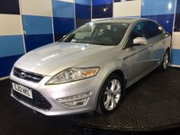 "USED 2012 12 FORD MONDEO 2.2 TITANIUM X TDCI 5d 197 BHP A truely stunning example of this very highly sought after family diesel hatchback finished in unmarked silver paintwork  contrasted with 17"" alloy wheels .This car comes equipped with half leather interior with heated/cooled front seats,dab radio with aux imputs ,front and rear parking sensors ,bluetooth phone preparation ,hill launch,power fold mirrors ,cruise control/speed limiter,dual zone climate control ,voice control system plus all the usual titanium refinements ,wonderful performace ."