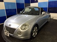 "USED 2006 DAIHATSU COPEN 1(l800) A unique opportunity to purchase one of this highly sought after funky little convertable,this car is finished in unmarked metalic silver with 15"" alloy wheels.Only having covered 27000 miles from new  comes with lots and lots of history plus all bills.This car comes equiped with all the usual refinements and amazingly is available for the summer ,be quick!!!"