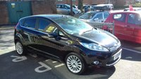 USED 2012 12 FORD FIESTA 1.4 TITANIUM 5d AUTO 96 BHP AUTOMATIC WITH EXCELLENT SPECIFICATION INCLUDING PARKING SENSORS, FRONT HEATED SCREEN, ALLOY WHEELS, CLIMATE CONTROL, AND LOW MILEAGE WITH ONLY 14159 MILES FROM NEW!