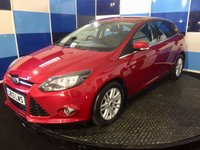 USED 2013 13 FORD FOCUS 2.0 TITANIUM TDCI 5d AUTO 139 BHP A truely pristine example of this highly sought after diesel automatic  family hatchback finished in an unmarked metalic red paintwork contrasted with 14 spoke alloys.This car comes with all the usual titanium refinements including cruise control and speed limiter,dual zone climate control ,front and rear foglamp,power fold mirrors ,dab cd radio with usb and aux imputs ,bluetooth phone prep,door edge protectors . This car looks and drives superbly returning a very creditable combined mpg of 53.3