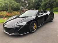 "USED 2014 14 MCLAREN 650S 3.8 V8 SPIDER 2d AUTO 630 BHP FACTORY SPECIFICATION: 20"" Super Lightweight Forged Matt Black Alloy Wheels, Meridian Surround Sound System, Carbon Fibre Interior Upgrade, Electric Adjustable Heated Memory Seats, Front and Rear Parking Sensors + Reversing camera, Alloy Oil and Coolant Caps, Vehicle Lift System, Alcantara Steering Wheel, Contrast Piping, Yellow Brake Calipers, Branded Floor Mat Set, Carbon Ceramic Brakes, Mclaren IRIS II Infotainment S"