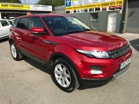 2012 LAND ROVER RANGE ROVER EVOQUE 2.2 ED4 PURE 5d 150 BHP IN METALLIC RED WITH A BLACK ROOF. £14499.00