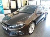 USED 2011 T VOLKSWAGEN SCIROCCO 2.0 GT TDI BLUEMOTION TECHNOLOGY DSG 2d AUTO 140 BHP This Scirocco is finished in black oak brown metallic with cloth seats. It is fitted with comfort and sport mode, power steering, remote locking, electric windows and mirrors, rear park assist, dual zone climate control, auto lights, Sat Nav, Bluetooth, Start/Stop, rear parking sensors, alloy wheels, DAB CD Stereo with Aux & Media port and more. It has been privately owned and has a full VW service history consisting of 5 VW stamps. The important emissions recall has been carried out.