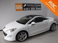 USED 2011 61 PEUGEOT RCZ 1.6 THP GT 2d 156 BHP FULL SERVICE HISTORY,FINISHED IN GLEAMING WHITE WITH FULL BLACK HEATED LEATHER, WE CHANGE THE TIMING CHAIN HAS BEEN DONE IN ARE RAC APPROVED WORK SHOP, LEATHER CLAD FLAT BOTTOM STEERING WHEEL, ELEC FOLD MIRRORS, CRUSE CONTROL, DUAL CLIMATE CONTROL, USB AUX LEAD, PARKING SENSORS, BLUETOOTH PHONE PREP   Call Now on 0151525 4400,  07967141248