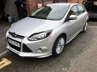 "USED 2013 13 FORD FOCUS 1.6 ZETEC S ECOBOOST 5d 178 BHP A stuuning example of this highly sought after family hatchback finished in unmarked silver paintwork enhanced by the body kit that sets it apart from the base models this car looks and drivers superbly returning a very creditable combined mpg of 47.1 .This car comes with satelite navigation,bluetooth phone preparation ,dab radio with usb and aux imputs ,17"" multispoke alloys, power folding mirrors heated front and rear screens ,stop start system, plus the wonderful park pilot to fool everybody."