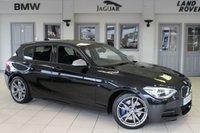 USED 2015 15 BMW 1 SERIES 3.0 M135I 5d AUTO 316 BHP FULL BLACK LEATHER SEATS + FULL BMW SERVICE HISTORY + PRO SATELLITE NAVIGATION + BLUETOOTH + XENON HEADLIGHTS + HEATED FRONT SEATS + 18 INCH ALLOYS + REAR PARKING SENSORS + DAB RADIO