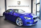 USED 2014 64 BMW M6 4.4 2DR AUTO 553 BHP 1 Owner service plan SAN MARINO METALLIC BLUE WITH FULL SILVERSTONE LEATHER INTERIOR + FULL BMW SERVICE HISTORY + 1 OWNER FROM NEW + PRO SATELLITE NAVIGATION + HEAD-UP DISPLAY + HEATED SPORT SEATS + BLUETOOTH + REVERSE CAMERA + HARMAN/KARDON SPEAKERS + SOFT-CLOSE DOORS + 20 INCH ALLOY WHEELS