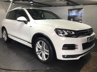 USED 2014 14 VOLKSWAGEN TOUAREG 3.0 V6 R-LINE TDI BLUEMOTION TECHNOLOGY 5d AUTO 242 BHP Panoramic electric glass sunroof  :  Bluetooth  :  Sat Nav  :  DAB Radio  :  Leather upholstery :  Heated/Electric front seats :  Paddleshift controls  :  Rear view camera :  Front and rear sensors  :  Remotely operated tailgate  :  Fully stamped service history