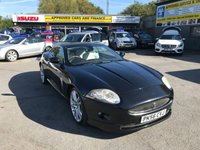 2006 JAGUAR XK 4.2 COUPE 2d AUTO 294 BHP IN BLACK WITH FULL CREAM LEATHER AND A FULL SERVICE HISTORY A TRULY STUNNING CAR. £9999.00