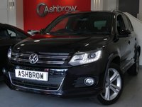 USED 2015 65 VOLKSWAGEN TIGUAN 2.0 TDI BLUEMOTION TECH R LINE 4MOTION DSG 5d 150 S/S 1 OWNER FROM NEW, FULL SERVICE HISTORY, DSG AUTOMATIC GEARBOX, START STOP TECHNOLOGY, SAT NAV, LED XENON LIGHTS, HEADLAMP WASHERS, FRONT FOG LIGHTS, SILVER ROOF RAILS, 18 INCH TWIN 5 SPOKE ALLOY WHEELS, FRONT & REAR PARKING SENSORS WITH DISPLAY (PARK PILOT), PARK ASSIST WITH AUTOMATIC STEERING, GREY CLOTH INTERIOR, SPORT SEATS, LEATHER FLAT BOTTOM MULTIFUNCTION STEERING WHEEL, ALUMINIUM PEDALS, LIGHT & RAIN SENSORS, AUTO DIMMING REAR VIEW, AUX & USB INPUTS, DAB RADIO, BLUETOOTH PHONE & MUSIC
