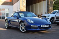 "USED 2009 09 PORSCHE BOXSTER 2.9 24V 2d 255 BHP Blue roof, blue sports heated leather seats, 18"" alloy wheels, rear parking sensor, Porsche embossed headrests, 2 keys, 7 service stamps."