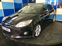 "USED 2012 12 FORD FOCUS 1.6 TITANIUM X 5d 148 BHP A very clean example of this much admired family hatchback finished in unmarked panther black further enhanced with 5 spoke 18"" alloy wheels.this car comes with full titanium x package including the wonder full park pilot system ,tyre pressure monitoring system,hill assist.traction control ,auto lights and wipers,dual zone climate control,cruise control and speed limiler ,half leather trim with heated front seats and electric adjust on drivers seat,truely a wonderful spec car."