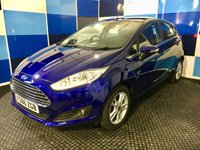 "USED 2016 66 FORD FIESTA 1.0 ZETEC 5d 99 BHP A wonderfull example of this family favorite 5 door hatchback finished in unmarked deep impact blue metalic complemented with 5 twin spoke 15"" alloy wheels ,this car comes with full service history ,still under manufacturers warranty till nov 2019 .This vehicle is equiped with all the usual zetec refinements including bluetooth phone preparation,dab radio cd player with usb , front fog lamps,start stop facilty . This car returns a combined ecconomy of 65.7mpg in conjunction with zero road tax."